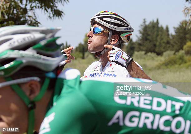 Italian rider Paolo Bettini gestures during the second stage of the Giro d'Italia cycling race 206 km leg from Tempio Pausania to Bosa on the Italian...