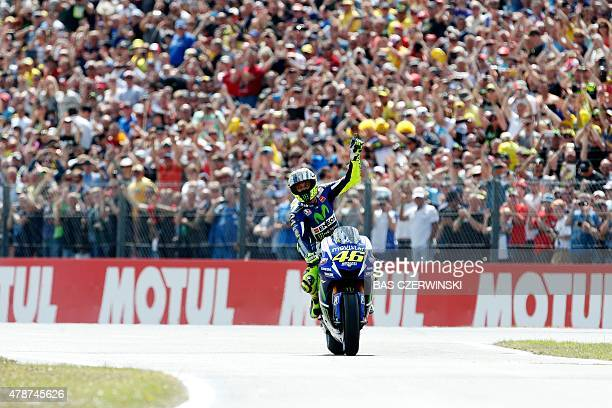 Italian rider Valentino Rossi celebrates his victory during the Dutch MotoGP race in Assen on June 27, 2015. AFP PHOTO / ANP BAS CZERWINSKI...