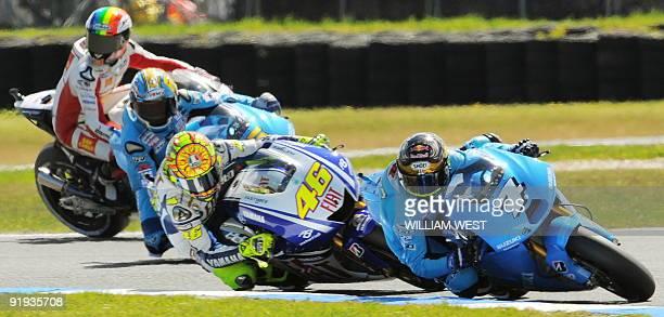 Italian rider Valentino Rossi chases Australian Chris Vermeulen through as corner as Loris Caprirossi of Italy and Alex de Angelis of San Marino look...