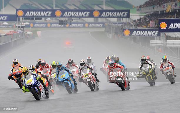 Italian rider Valentino Rossi of Fiat Yamaha takes the lead at the start of the Malaysian Motocycle Grand Prix in Sepang on October 25 2009 AFP...