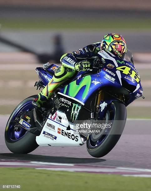 Italian rider Valentino Rossi of Movistar Yamaha competes during the Qatar Moto Grand Prix race on March 20 2016 at the Losail International Circuit...