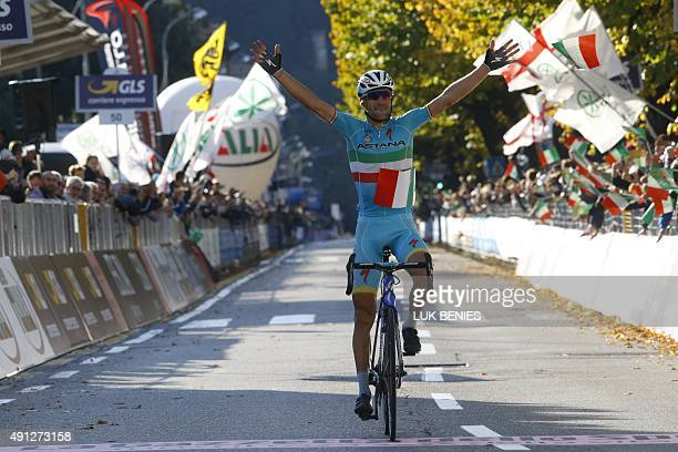 Italian rider Vincenzo Nibali celebrates as he won the 109th edition of the Giro di Lombardia a 245 km cycling race from Bergamo to Como on October 4...