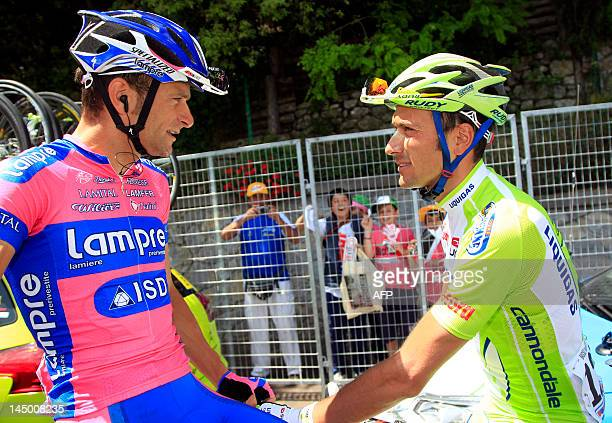 Italian riders Michele Scarponi and Ivan Basso chat at the start of the 16th stage of 'Giro' Tour of Italy cycling race a 173km ride from Limone sul...