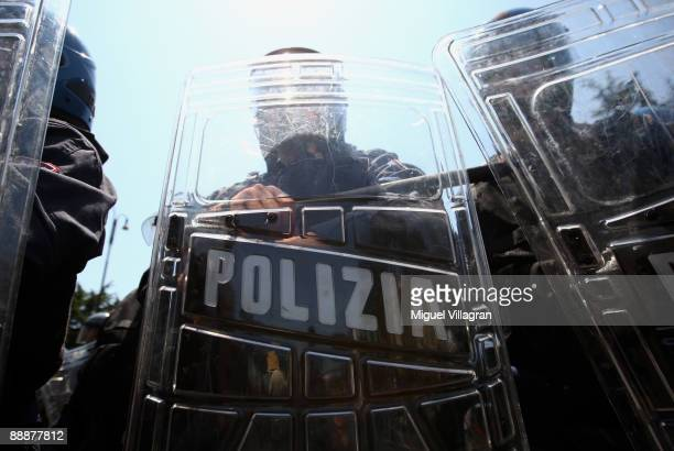 Italian riot police stand guard during a demonstration near the Sapienza university prior to the arrival of the world G8 leaders for their summit on...