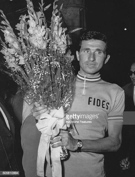 Italian road cyclist Arnaldo Pambianco holding a bouquet of flowers as he arrives in his home town after winning the Tour of Italy race Bertinoro...