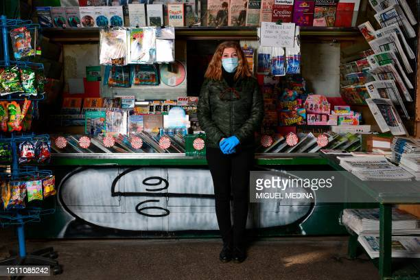 Italian Rosy Varrella newspapers kiosk owner, poses for a picture in centre Milan, Italy on April 23, 2020 during the COVID-19 coronavirus pandemic....