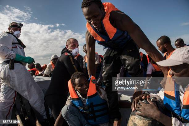Italian sailors with the Uraniam Navy Ship rescue 109 African migrants from Gambia Mali Senegal Ivory Coast Guinea and Nigeria from a rubber boat in...
