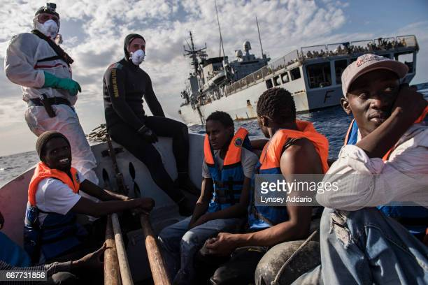 Italian sailors with the Uraniam Navy Ship rescue African migrants from Gambia Mali Senegal Ivory Coast Guinea and Nigeria from a rubber boat and...