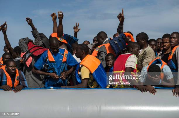 Italian sailors with the Uraniam Navy Ship rescue African migrants from Gambia Mali Senegal Ivory Coast Guinea and Nigeria from a rubber boat in the...