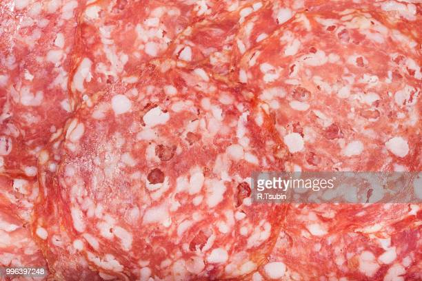italian salami with slices cut, close up - pepperoni stock photos and pictures