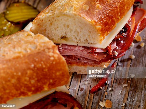 italian sandwich with salami,genoa, prosciutto, provolone and red peppers - sausage bap stock photos and pictures
