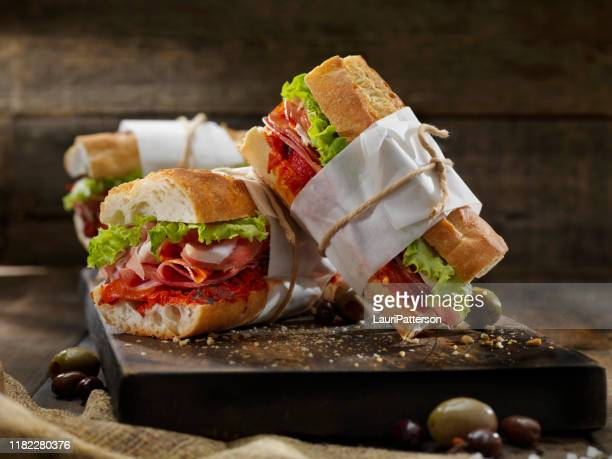 italian sandwich's with roasted red peppers - submarine sandwich stock pictures, royalty-free photos & images