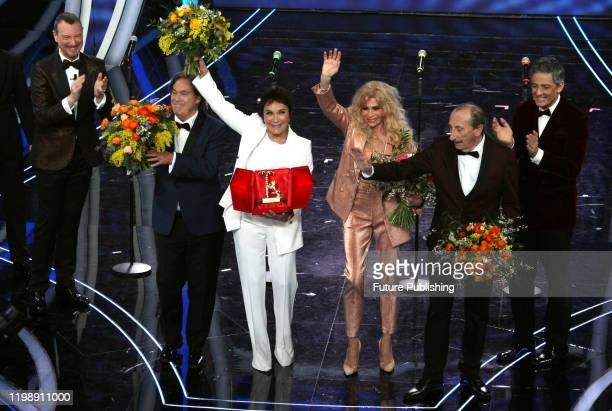 Italian Sanremo Festival artistic director Amadeus members of the Italian band Ricchi e Poveri Angelo Sotgiu Angela Brambati Marina Occhiena and...