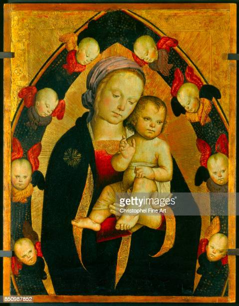 Italian School Madonna and Child in a Glory of Seraphim Oil on wood 037 x 047 m Avignon musee du Petit Palais