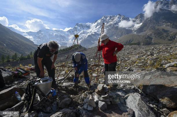 Italian scientists and experts about glaciers check the level of ice lost on the Belvedere Glacier on September 26 2015 on the Monte Rosa The...