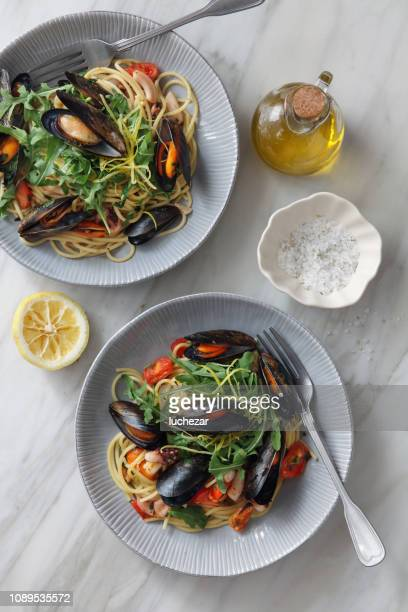 italian seafood pasta with mussels and calamari - mottled skin stock pictures, royalty-free photos & images