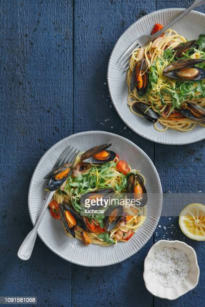 italian seafood pasta with mussels and calamari - mussel stock pictures, royalty-free photos & images
