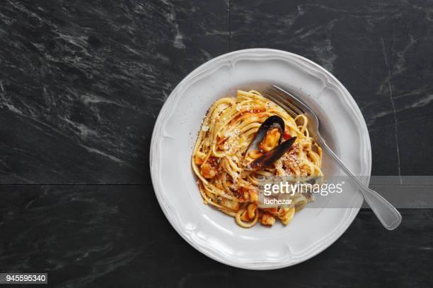 italian seafood pasta with mussels and calamari - marinara stock photos and pictures