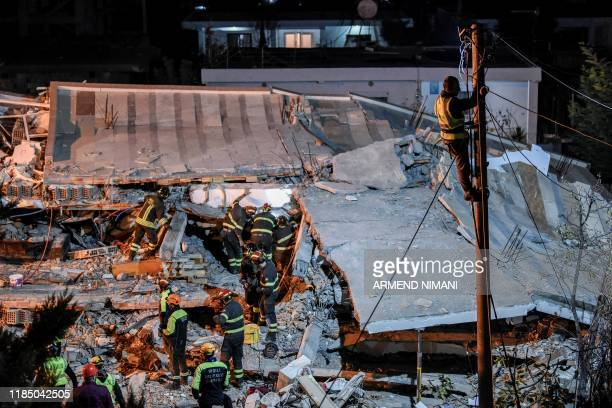 Italian search and rescue team search for six members of Lala family stuck under the rubble of a collapsed building in the town of Durres on November...
