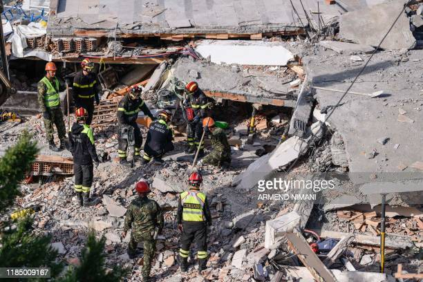 Italian search and rescue workers look for survivors stuck under the rubble of a collapsed building in the town of Durres western Albania on November...