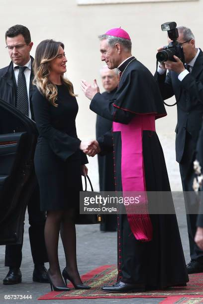 Italian Secretary of the Council of Ministers Maria Elena Boschi is welcomed by the prefect of the papal household Georg Gaenswein as she arrives at...
