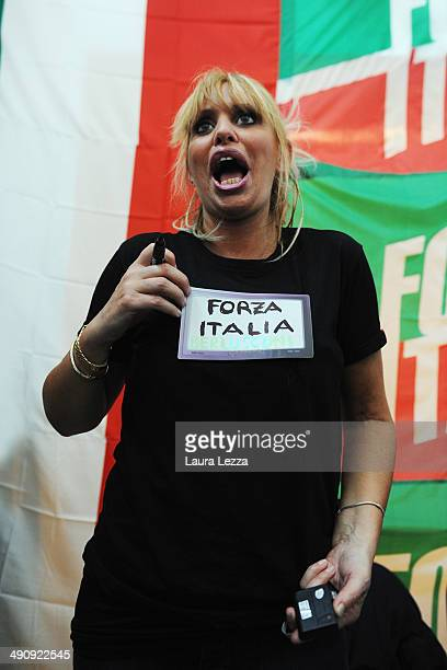 Italian Senator Alessandra Mussolini holds a rally ahead of Election Campaign and wears a homemade tshirt that turns on and supports the party Forza...