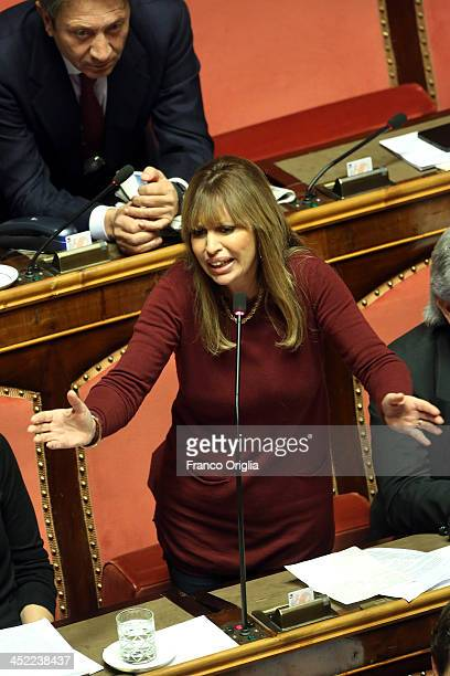Italian Senator Alessandra Mussolini holds her proBerlusconi speech during the discussion before the votes over Silvio Berlusconi's Parliament...