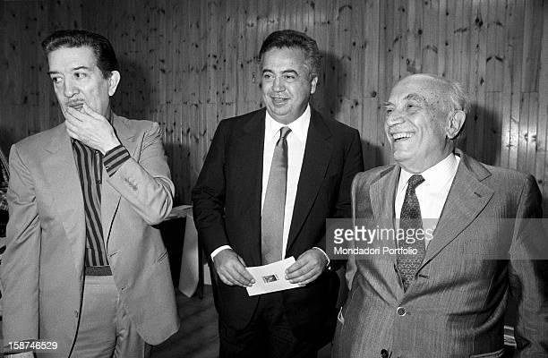 Italian senator Amintore Fanfani smiling with Italian senator Franco Evangelisti and Italian entrepreneur and publisher Giuseppe Ciarrapico during...