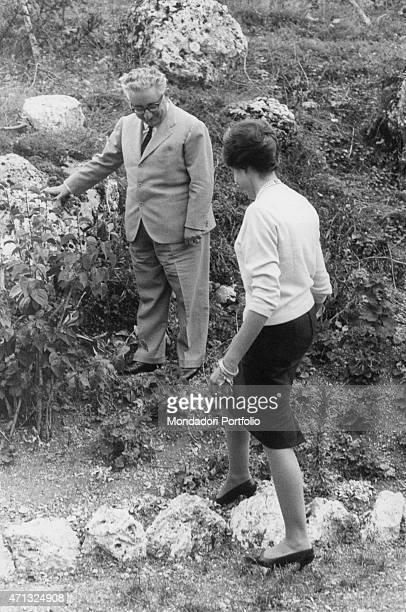 Italian senator and future President of the Italian Republic Giovanni Leone walking in a garden with his wife Vittoria Michitto . Roccaraso, 1962