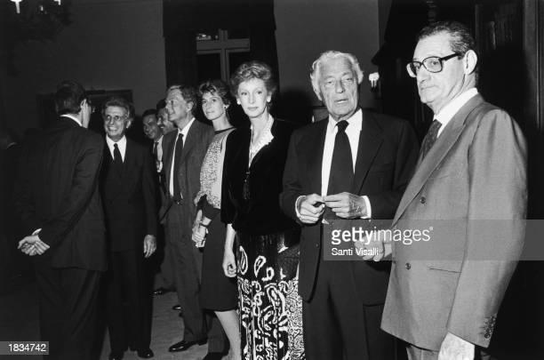 Italian senator Furio Colombo Umberto Agnelli and wife Allegra Caracciolo Marella Agnelli Gianni Agnelli and Cesar Romiti attend a party for the Fiat...