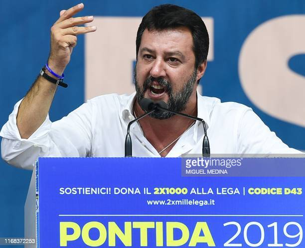 Italian senator head of the Italian farright League party Matteo Salvini delivers a speech on stage during the party's annual rally in Pontida on...