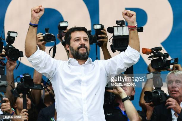 Italian senator head of the Italian farright League party Matteo Salvini acknowledges applause on stage during the party's annual rally in Pontida on...