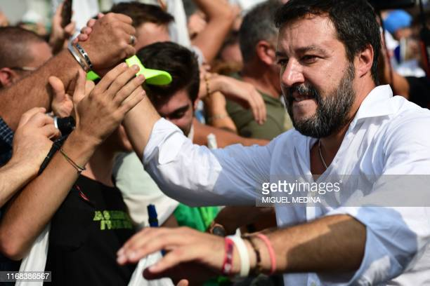 Italian senator, head of the Italian far-right League party Matteo Salvini goes to meet with supporters after delivering a speech at the party's...