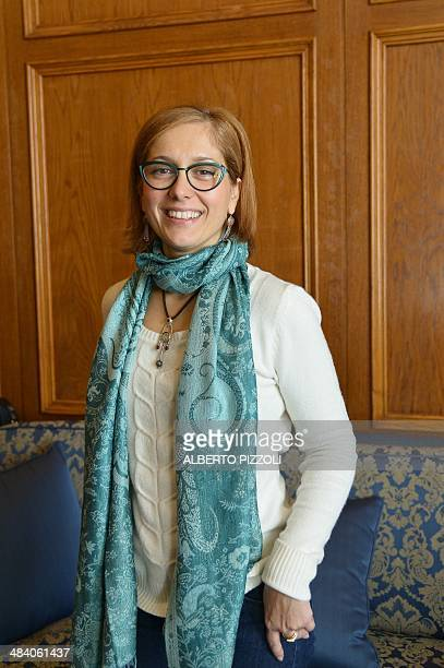 Italian senator Michela Montevecchi of the Five Star Movement, speaks with a journalist during a meeting on April 10, 2014 in Rome. AFP PHOTO /...