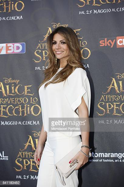 Italian showgirl actress and TV presenter Alessia Ventura posing on the red carpet at the national premiere of the film 'Alice Through the Looking...