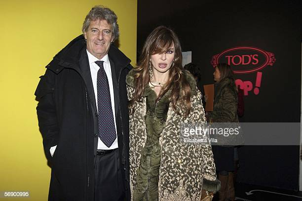 Italian showgirl Alba Parietti and Giuseppe Lanza Di Scalea arrive to attend Tod's Pops party on the fourth day of Milan Fashion Week at PAC on...