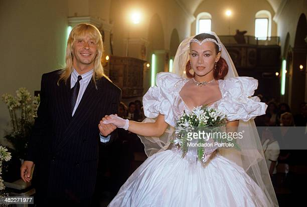 Italian showgirl Carmen Russo holding Italian dancer Enzo Paolo Turchi by the hand on their wedding day 1987