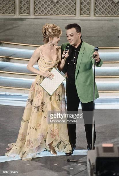 Italian showgirl Lorella Cuccarini talking to Italian singersongwriter Enrico Ruggeri winner of the 43rd Sanremo Music Festival Sanremo February 1993