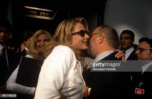 Italian showgirl Valeria Marini hugging and kissing Gianfranco Ferré in the backstage of his spring/summer collection event in the background the TV...