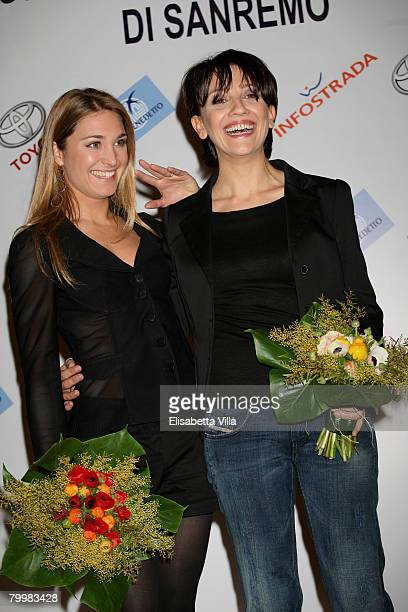 Italian showgirls Lucilla Agosti and Lucia Ocone pose after a press conference for the TV show 'Il Dopofestival' at the Teatro Ariston on February...