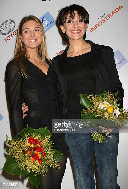 Italian showgirls Lucilla Agosti and Lucia Ocone pose after a press conference for the TV show 'Il Dopofestival' at the Teatro Ariston on February 25...