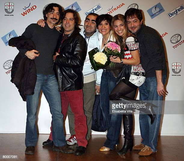 Italian showgirls Lucilla Agosti and Lucia Ocone pose with the Italian band Elio e le Storie Tese after a press conference for the tv show 'Il...