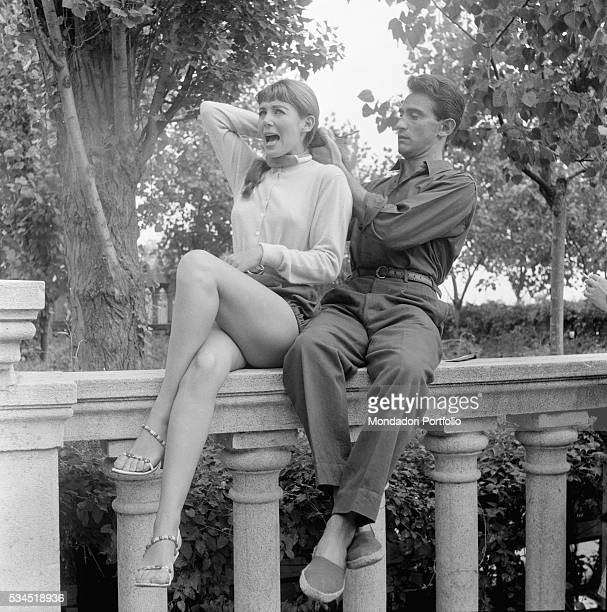 Italian showman Walter Chiari pulling French actress Myriam Bru's hair during the XVIII Venice International Film Festival Venice 1957