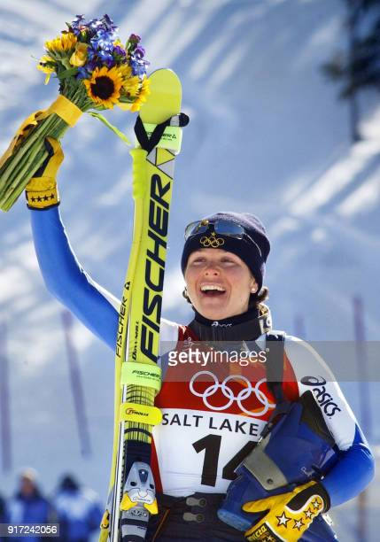 Italian silver medalist Italian Isolde Kostner waves after the Women's Downhill in the 2002 Olympic Women's Downhill in Snowbasin 12 February 2002...