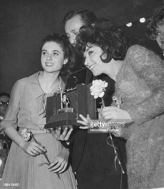 Italian singer actress and TV presenter Gigliola Cinquetti and Italianborn Belgian singer Patricia Carli receiving the prize for the song Non ho...