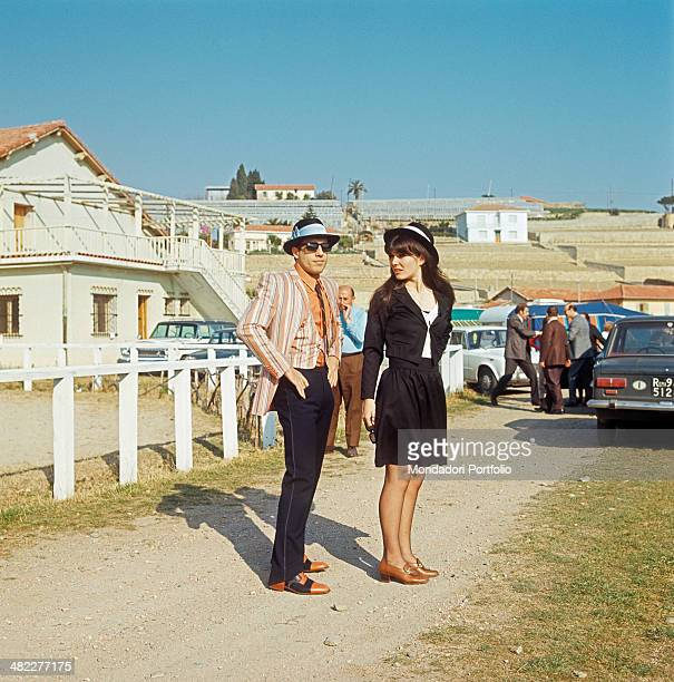 Italian singer Adriano Celentano and his wife Claudia Mori posing together in the street at the 18th Sanremo Music Festival Sanremo February 1968