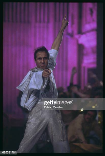 Italian singer Adriano Celentano who interprets the title role and directs the film Joan Lui appears on stage during a dance number A musical comedy...