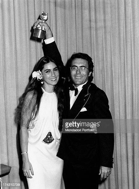 Italian singer Al Bano and his wife Americanborn Italian singer Romina Power posing smiling The duo has just won the 34th Sanremo Music Festival...