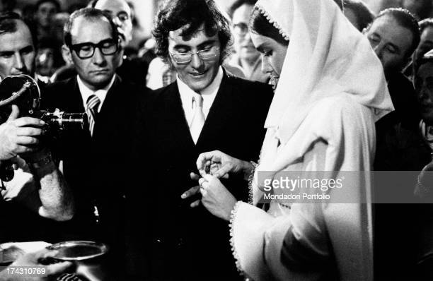 Italian singer Al Bano and his wife Americanborn Italian singer Romina Power exchanging their wedding rings on their wedding day The best man is...