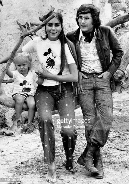 Italian singer Al Bano his wife Americanborn Italian singer Romina Power and their daugther Ylenia Carrisi posing sitting on a trunk Cellino San...